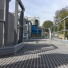 Standard Open Mesh GRP Grating on a raised maintenance platform with GRP Handrail either side