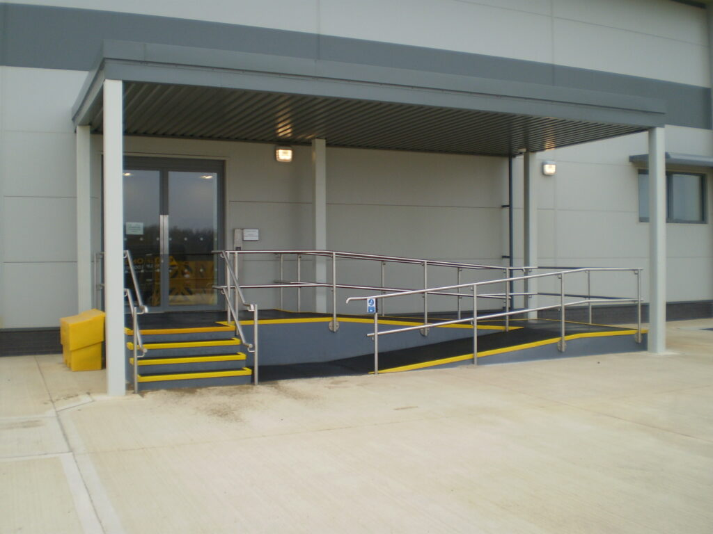 Stairs and a disabled access ramp with QuartzGrip GRP stair tread covers and flat plate