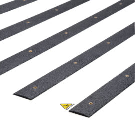 Close-up of black QuartzGrip Decking Strips showing the anti-slip finish