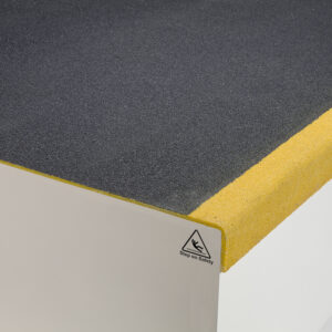 Close-up of black & yellow QuartzGrip Landing Cover showing the anti-slip finish