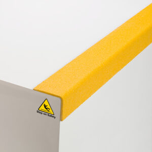 Close up of yellow QuartzGrip GRP stair nosing showing the anti-slip finish