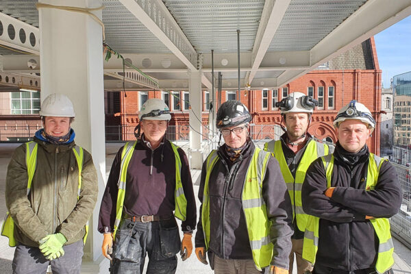 One of the Step on Safety installation teams onsite. All wearing hi-vis vests, hard hats and safety gloves
