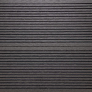 Close-up of RecDeck black composite decking boards showing the slip-resistant grooved texture