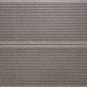 Close-up of RecDeck light grey composite decking boards showing the slip-resistant grooved texture