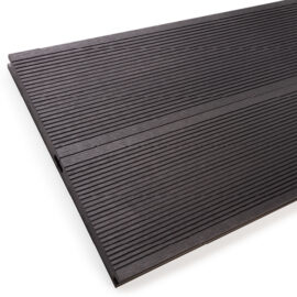 Close up of RecoDeck solid WPC decking boards in grooved black finish