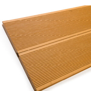 Close up of RecoDeck solid WPC decking boards in grooved teak finish