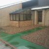 Green QuartzGrip solid top panels used to cover a trench within a residential complex