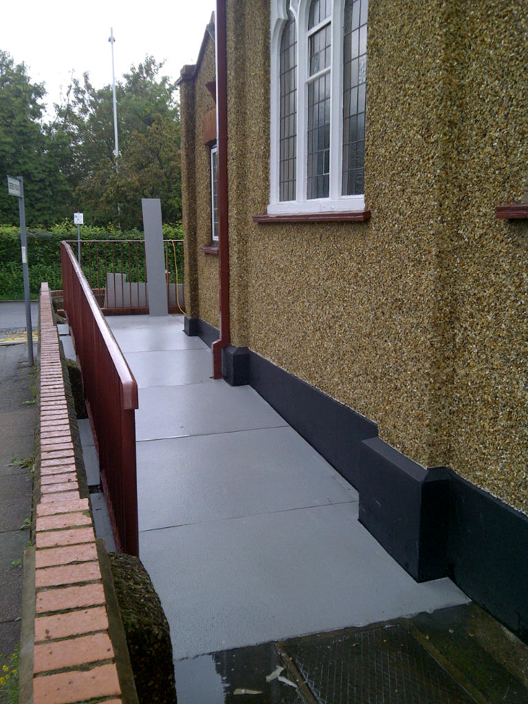 A smooth disabled access ramp outside a church in Hillingdon surfaved with GRP anti-slip floor covering