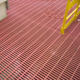 Red Phenolic GRP Grating installed on a maintenance platform