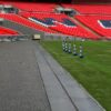 A long GRP olid top trench cover running around the edge of the pitch at Wembley Stadium