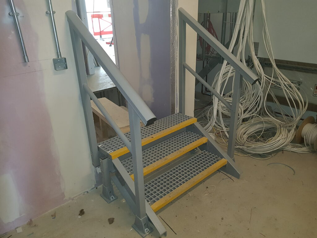 Small access staircase leading to a new doorway