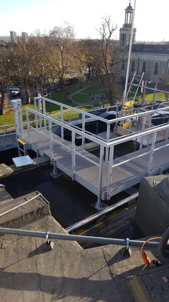 Roof-top gantry providing safe access to maintenance crews