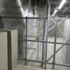 A screen constructed using GRP profiles and ScreenGuard GRP mesh to restrict access within the plant room at Ikea in Sheffield
