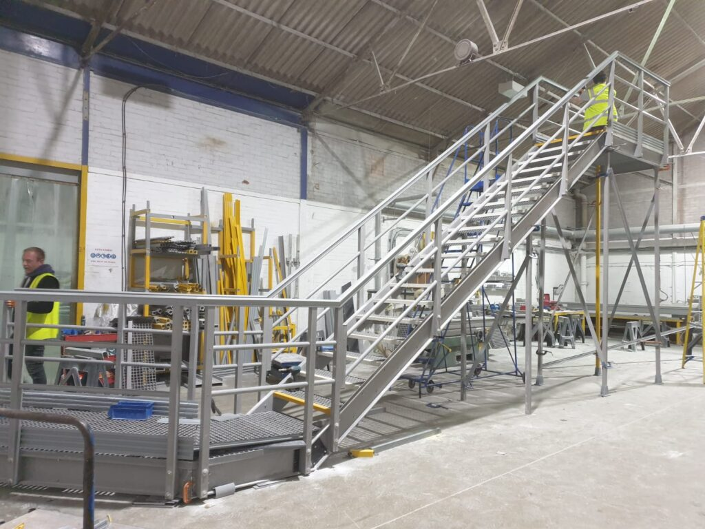 A GRP embankment staircase being constructed at the Step on Safety workshop in Suffolk