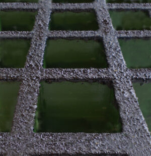 Close up of green GRP grating with a non-conductive coating