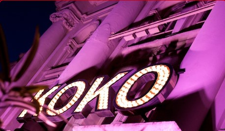 A night time shot of the frontage of KOKO in Camden flooded with purple light