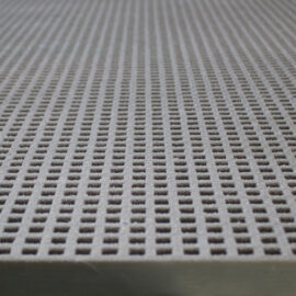 A close-up of a panel of QuartzGrip GRP Mini Mesh Grating in grey showing the slip-resistant, gritted finish