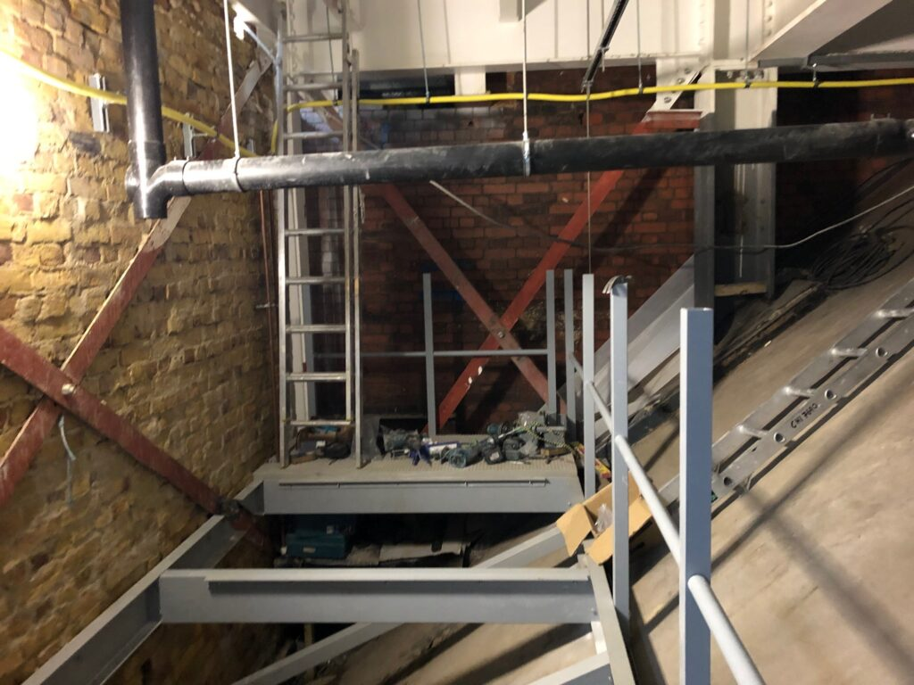 Construction of a suspended walkway at KOKO in Camden. Photo shows the GRP profile structure in place