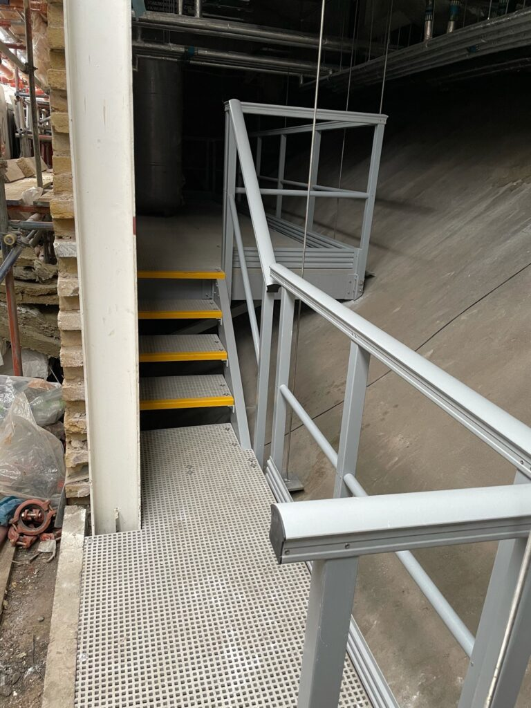 Completed GRP suspended walkway at KOKO in Camden looking at the access steps and GRP handrail