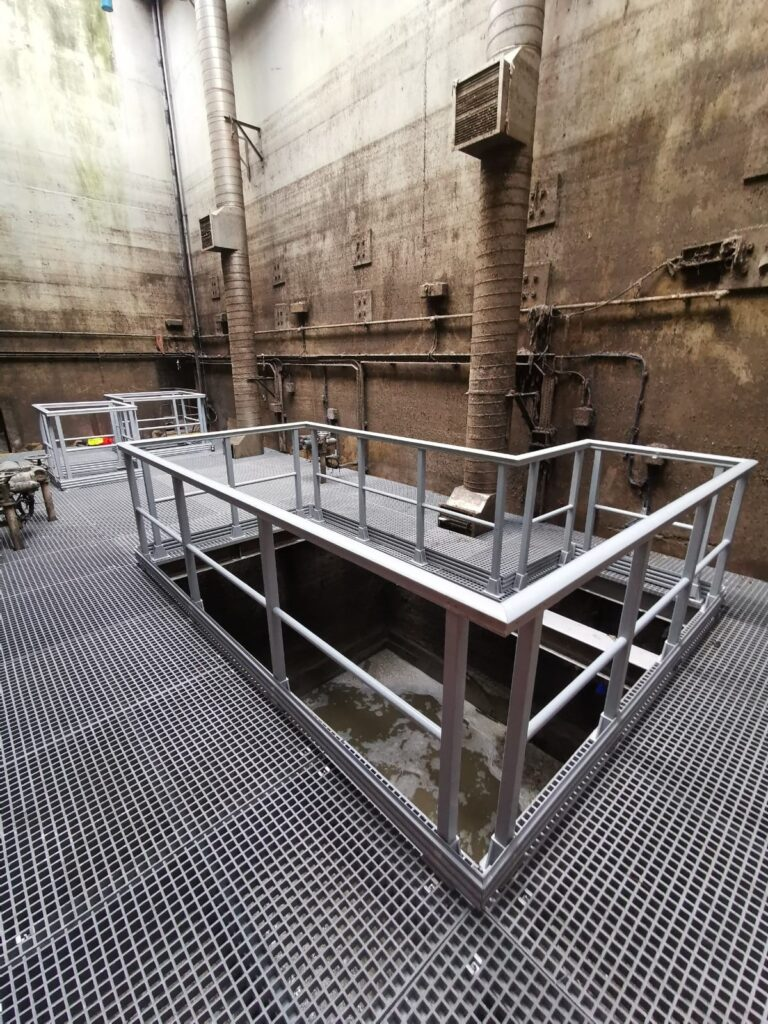 A suspended maintenance platform built using GRP profiles, open mesh and handrail and installed 11m down in a foul water chamber at Anglian Water's London Road Pumping Station in West Thurrock.