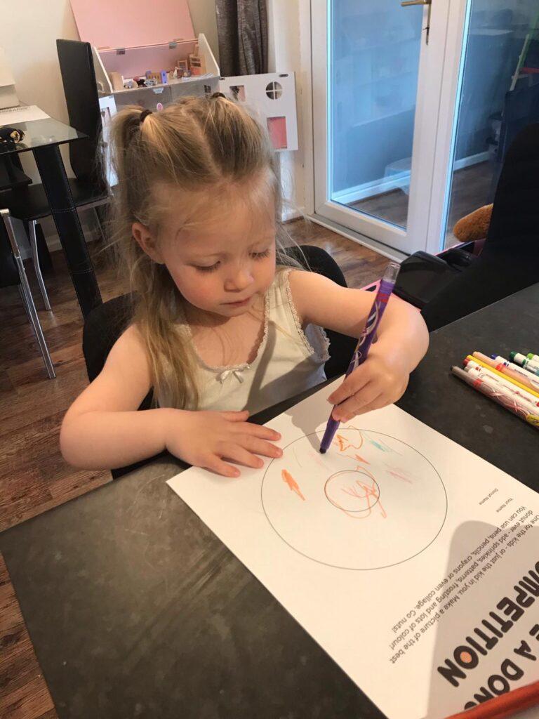 Little girl colouring a donut
