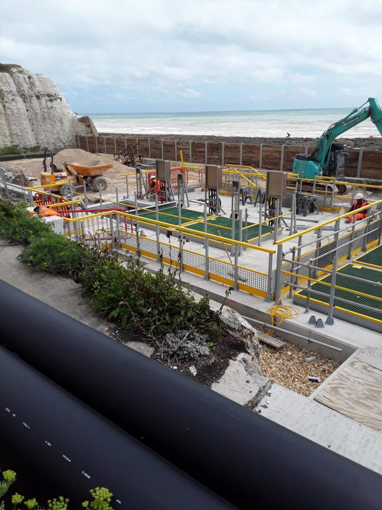 Photo taken from the cliffs of work taking place at the Portobello Pumping Station